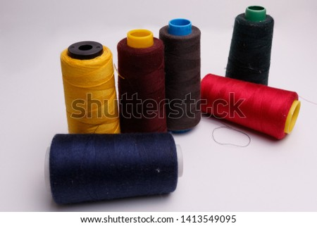 Colourful spools of thread on white background #1413549095