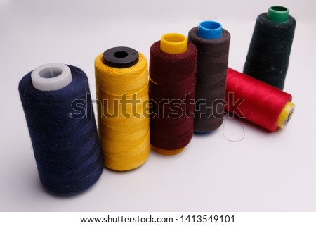 Colourful spools of thread on white background #1413549101