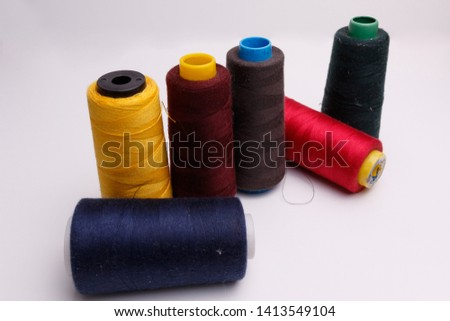 Colourful spools of thread on white background #1413549104