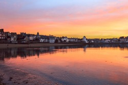 Colourful sunset on typical houses at the beach of Saint-Malo, Brittany, France