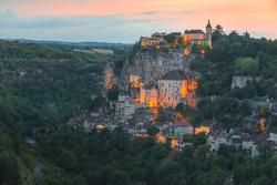 Colourful sunset or sunrise view of the French medieval hilltop village of Rocamadour, France in the Dordogne Valley.