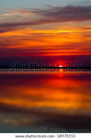 Colourful sunset over a lake in Alberta - stock photo