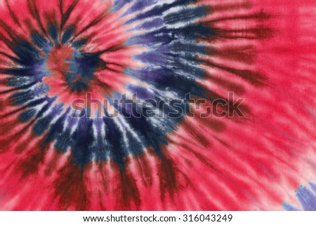 266e27292ced colourful tie dyed pattern on cotton fabric abstract background.  316043249