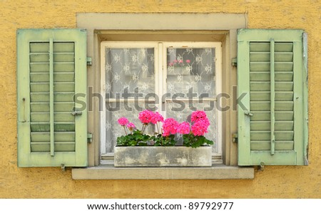 Colourful window with shutters.