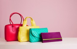 Colourful woman bags on pink background