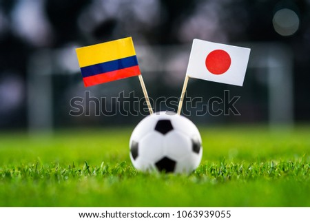 Columbia - Japan, Group H, Tuesday, 19. June, Football, World Cup, Russia 2018, National Flags on green grass, white football ball on ground. #1063939055