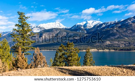 Columbia Lake which is the headwaters of the Columbia River in the East Kootenays near Invermere British Columbia Canada in the early winter #1275753610