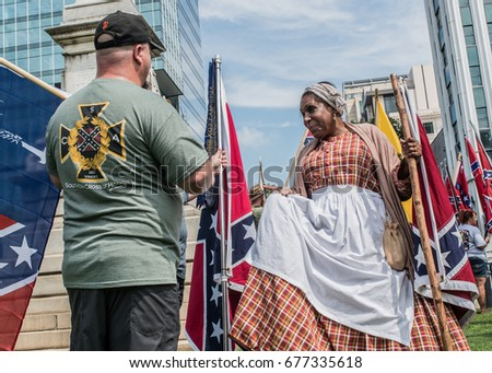 Columbia, South Carolina - July, 10, 2017: Confederate activist attend a flag raising event held in protest of the the Confederate flag's removal from the S.C. State House in 2015 #677335618