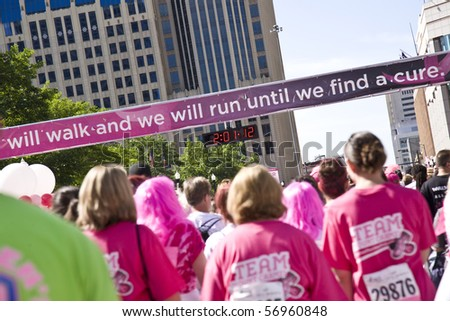 COLUMBUS, OHIO - MAY 15: A record crowd of people gather to participate in the Susan G. Komen Race for the Cure on May 15, 2010 in Columbus, Ohio. - stock photo