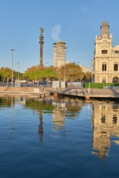 Columbus Pillar the waterfront shot from rambla de Mare of Barcelona Spain. Soft morning light effects reflections.