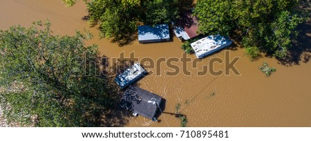 Columbus Texas USA Flood waters totally submerge homes and buildings as hurricane Harvey destroys everything along the Texas gulf coast August 30th 2017 #710895481