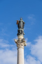 Column of the Immaculate Conception (La Colonna della Immacolata) at Piazza Mignanelli in Rome, Italy, 19th century monument to Virgin Mary carrying a wreath of flowers on ancient Corinthian column