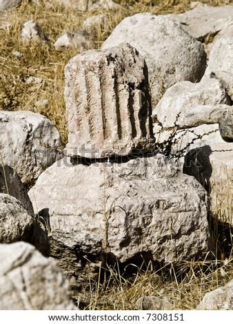 Column remains in Roman archaeological site in Amman Jordan.  Al-Qasr archaeological site.