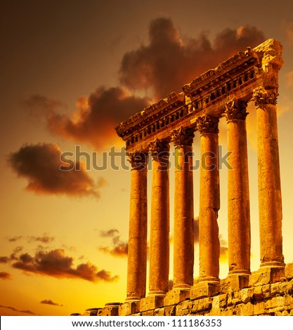 Column ruins over sunset, ancient lebanese building, Heliopolis Baalbek columns in Lebanon, arabian aged landmark, famous temple monument, travel, vacation, tourism concepts