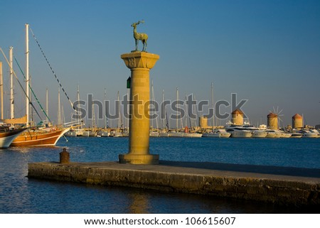 Column with a statue of a deer in Rhodes old port Mandraki, Rhodes, Greece - stock photo