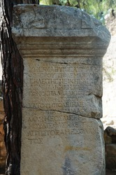 Column with text in Greek in the destroyed antique city of Faselis in the south of Turkey