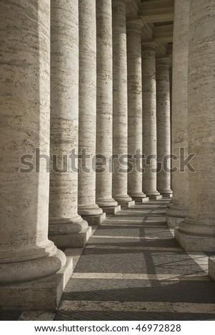 Columned hallway in Saint Peter's Square. Vertical shot.