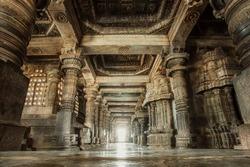 Columns and empty corridor inside the 12th century stone temple Hoysaleswara, now Karnataka state of India.