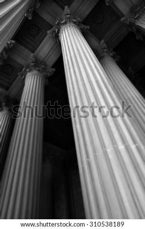 columns and name carved into...