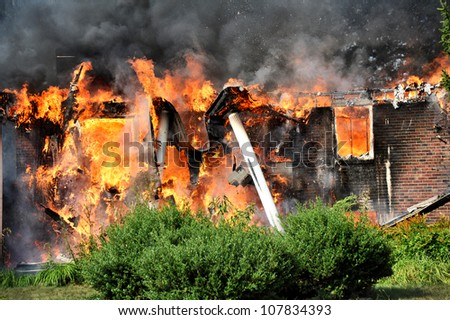 columns collapsing as house burns to ground