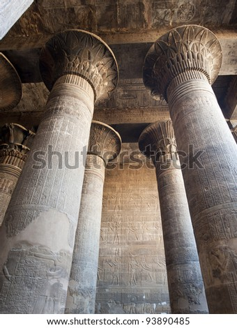Columns in the ancient egyptian temple of Khnum at Esna with hieroglyphic carvings