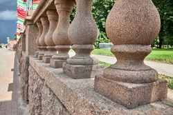 Columns of concrete fencing along the road near the park