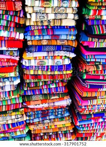 Columns of folded colorful blankets in bolivian street market, La Paz, Bolivia
