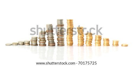 Columns of golden and silver coins isolated on white