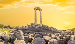 Columns of the ancient temple of Apollo in the ancient city of Didim in Turkey at sunset.Panorama