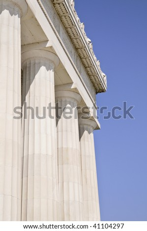columns of the Lincoln memorial against blue sky