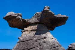 Columns, porches, natural sculptures and blue sky Weathered rock Because of the erosion of nature and time In the area of Pha Taem National Park, Ubon Ratchathani Province, Thailand