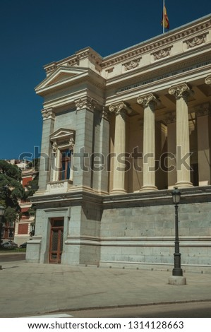 Columns with Ionic capitals on west facade of Casón del Buen Retiro, an annex of the Prado Museum complex in Madrid. Capital of Spain this charming metropolis has vibrant and intense cultural life.