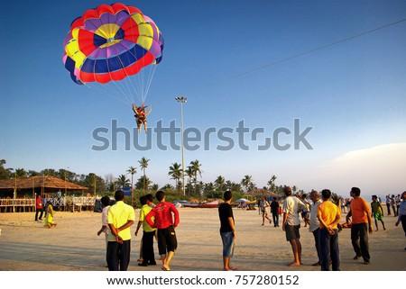 Colva Beach, South Goa, India. 15th October, 2016. Tourists enjoying adventure sports (Parasailing) at a sunny beach in Goa, India. Editorial.