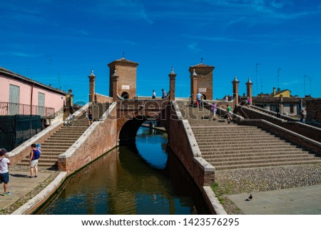Comacchio, Ferrara, Italy may 24, 2019. Trepponti Bridge with people in a sunny day. #1423576295
