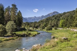 Comano, Italy - Sarca Creek with Trees and Mountains