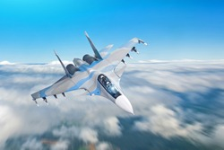Combat fighter jet on a military mission with weapons - rockets, bombs, weapons on wings flies motion blur high in the sky above the clouds
