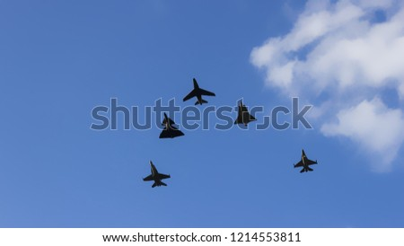 Combat squadron of supersonic aircraft on blue sky