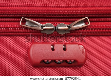 combination lock on a red suitcase travel