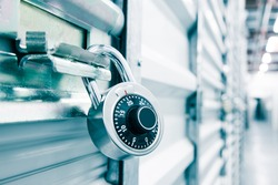 Combination lock on a self storage door. Life style, storage, moving, storing, organizing concept.