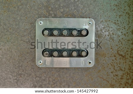 combination lock on the sheet of metal