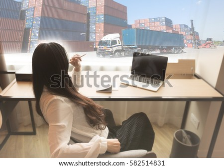 Combination of container picture and girl to link with online business concept, online marketing concept.  Girl is thinking about to manage a logistic