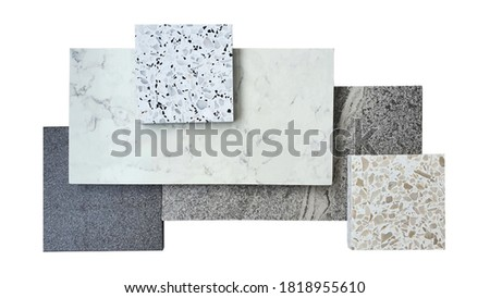combination of interior flooring material samples contains grey granite ,grey slate ,white marble ,white and beige terrazzo samples isolated on white background with clipping path. Foto stock ©
