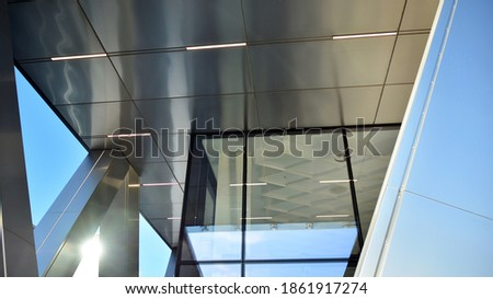 Combination of metal and glass wall material. Steel facade on columns. Abstract modern architecture. High-tech minimalist office building. Contemporary business architecture abstract fragment. Photo stock ©