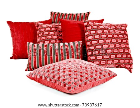 Combination of red and brown pillows on a white background - stock photo