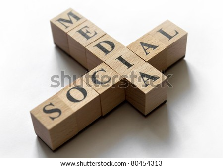 "Combination of the words ""social"" and ""media"" composed of cubes. Focused on ""I"" letter. Isolated on white."