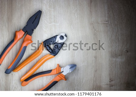 Combination pliers, diagonal cutting pliers and wire rope cutter. Tools for cutting solid materials and multi strand cables. Professional ergonomic tools.