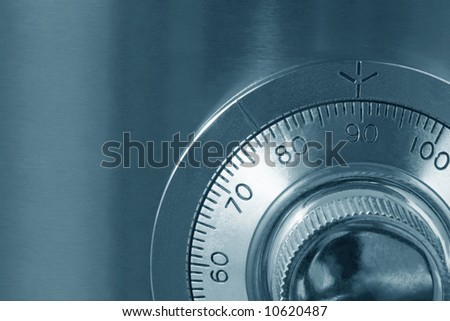 Combination safe lock, close-up view, in cyan tone.