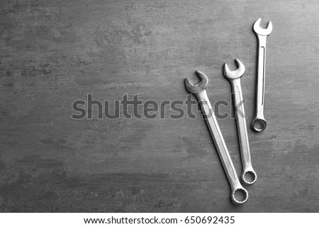 Combination wrenches for car repair on grey table