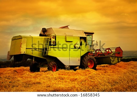 Combine harvester in sunset.