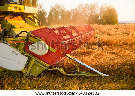 combine harvester working on a barley field